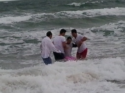 Baptism in the sea at Sandbanks